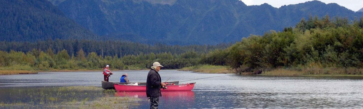 3 men fishing on river in Alaska